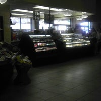 Photo taken at AJ's Fine Foods by Doug D. on 9/13/2012