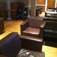 Photo taken at Wingtips Lounge by Sarah P. on 8/2/2012