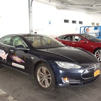 Photo taken at Tesla Supercharger by Vera S. on 7/16/2014