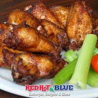 Photo taken at Red Hot & Blue BBQ by Red Hot & Blue BBQ on 7/2/2014