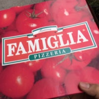 Photo taken at Famous Famiglia Pizza by Julius Erwin Q. on 1/16/2014