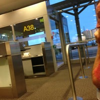 Photo taken at Gate A38 by Nele S. on 7/11/2013