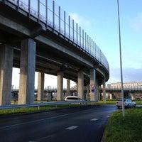 Photo taken at Dienvidu tilta Slāvu aplis by Janis V. on 11/12/2012