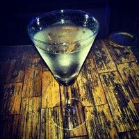 Photo taken at Enjoy Bar by Andy C. on 2/23/2013
