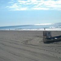 Photo taken at Washington Ave Beach (Ventnor) by Catherine B. on 8/6/2013