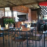 Photo taken at Buka Restaurant by Emmanuel O. on 4/16/2013