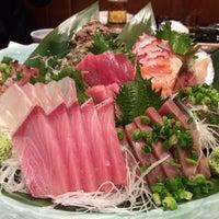 Photo taken at 三陸 by Satoshi T. on 1/10/2014