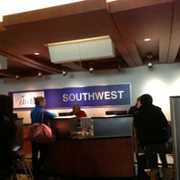Photo taken at Southwest Ticket Counter by Paul B. on 12/24/2013