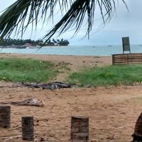 Photo taken at Praia Boca da Barra by Carlos H. on 7/17/2014
