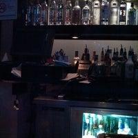 Photo taken at Bleu Restaurant & Bar by Elmer G. on 5/18/2014