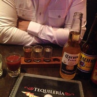 Photo taken at Tequileria La Perla by Alonso B. on 7/22/2013