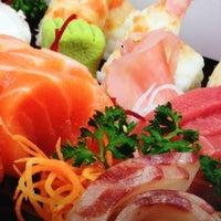 Photo taken at Uasabi Japanese Resto Bar by Ivan D. on 2/6/2013