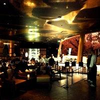 Photo taken at Kumi Japanese Restaurant + Bar by Andrew C. on 7/23/2013