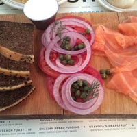 Photo taken at Russ & Daughters Café by Deana D. on 8/4/2014