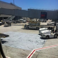 Photo taken at Gate C4 by Rick T. on 6/20/2012