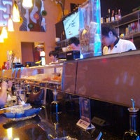 Photo taken at East Moon Asian Bistro by Ron W. on 9/3/2012