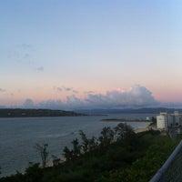 Photo taken at ウッパマビーチ by Yorihiko Paul K. on 7/28/2012