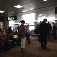 Photo taken at Gate A30 by Marcelle on 5/4/2012