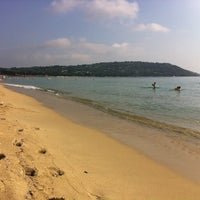 Photo taken at Plage de Pampelonne by Axel M. on 8/24/2012