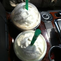 Photo taken at Starbucks by Ellekhaye on 7/4/2012