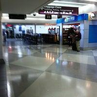 Photo taken at Gate B9 by Ariel P. on 6/2/2012