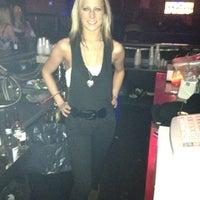 Photo taken at Status Lounge by Amanda V. on 4/7/2012