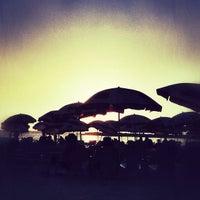 Photo taken at Frishman Beach by Dor H. on 7/15/2012