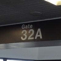 Photo taken at Gate 32A by Lauryn H. on 5/28/2012