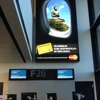 Photo taken at Gate G26 by Anna K. on 9/10/2012