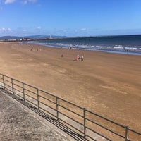 Photo taken at Swansea Bay Beach by Josep H. on 7/28/2012