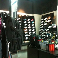 Photo taken at Addidas store by Nguyen K. on 7/23/2012