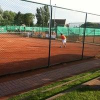 Photo taken at Tennis Club Duinbergen by Julie B. on 7/19/2012