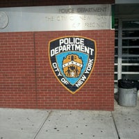 Photo taken at NYPD - 107th Precinct by Benjamin W. on 7/7/2012