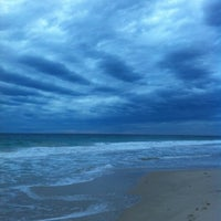 Photo taken at Scarborough Beach by Michelle S. on 5/4/2012