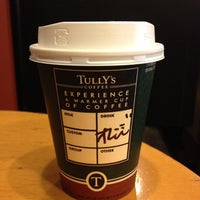 Photo taken at Tully's Coffee by Hiroshi K. on 2/24/2012