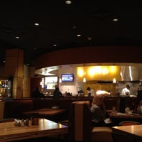 Photo taken at California Pizza Kitchen by Dinh P. on 3/27/2012