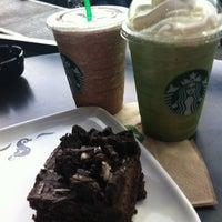 Photo taken at Starbucks by Denisse L. on 3/10/2012