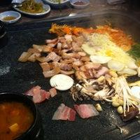 Photo taken at 제주오겹살 왕돌구이집 by JI MIN H. on 3/9/2012