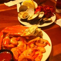 Photo taken at Phillips Seafood by Mónica C. on 7/24/2012