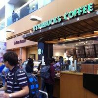 Photo taken at Starbucks by Elena M. on 6/16/2012