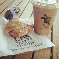 Photo taken at Uptown Espresso by Heidi G. on 9/6/2012