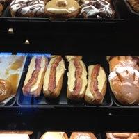 Photo taken at YoYo Donuts & Coffee Bar by Mark B. on 2/16/2012