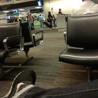 Photo taken at Gate 85 by Ivan G. on 7/14/2012