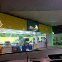 Photo taken at Petronas by Bibie A. on 4/12/2013