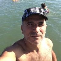 Photo taken at Albayrak Beach by Doğan H. on 7/30/2014