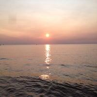 Photo taken at St. Joseph North Pier (at Tiscornia Park) by Chris F. on 7/18/2014