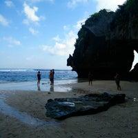 Photo taken at Suluban Beach by Kia Travel B. on 7/26/2015