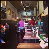 Photo taken at Golden Mean Vegan Cafe by Pablo V. on 5/18/2013