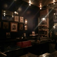 Photo taken at Mignon Wine & Cheese Bar by Travis F. on 10/18/2012