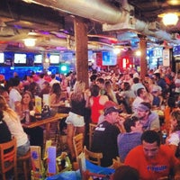 Photo taken at Sandbar Sports Grill by Michelle L. on 10/14/2012
